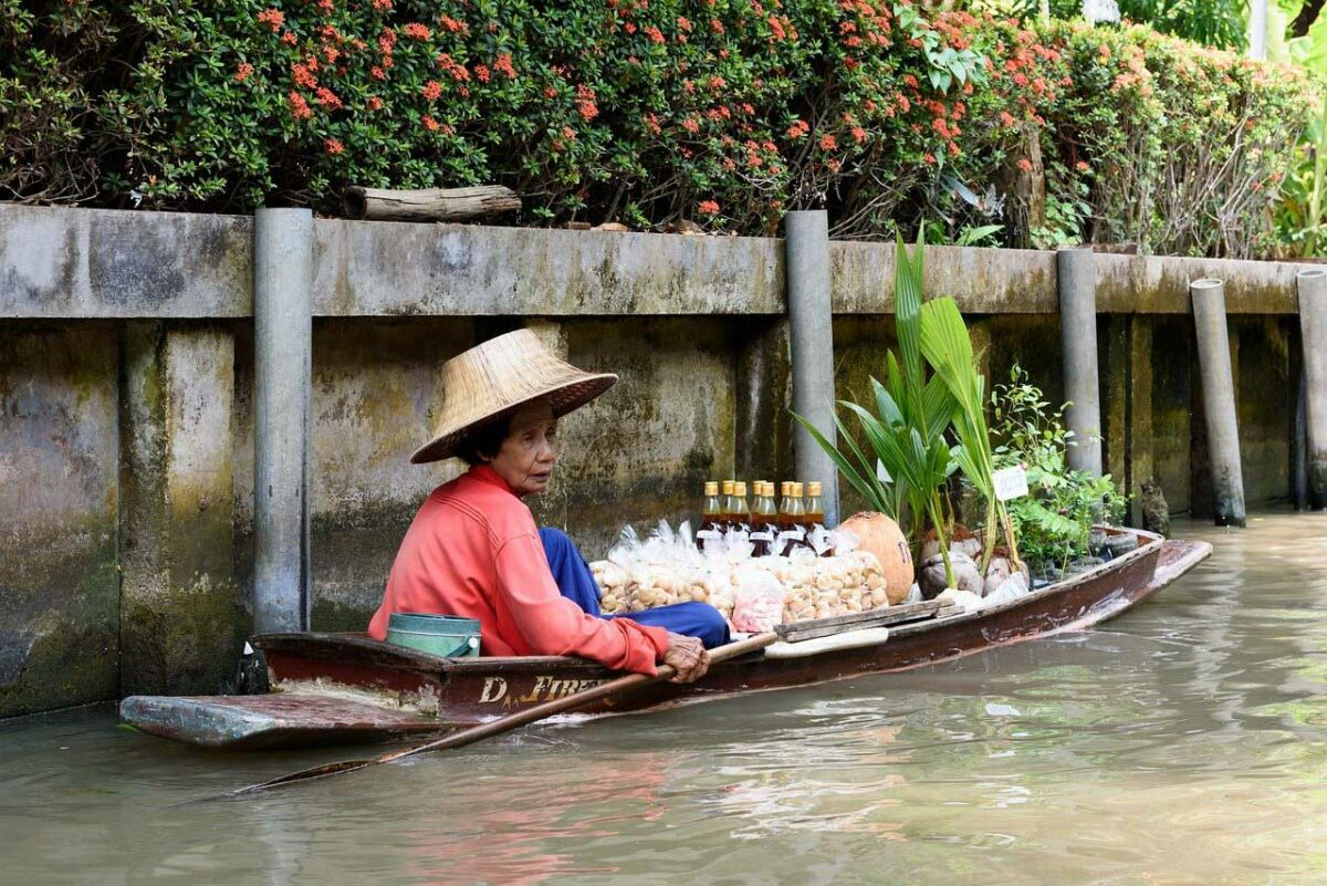 Vendor on a boat in a canal in Thailand