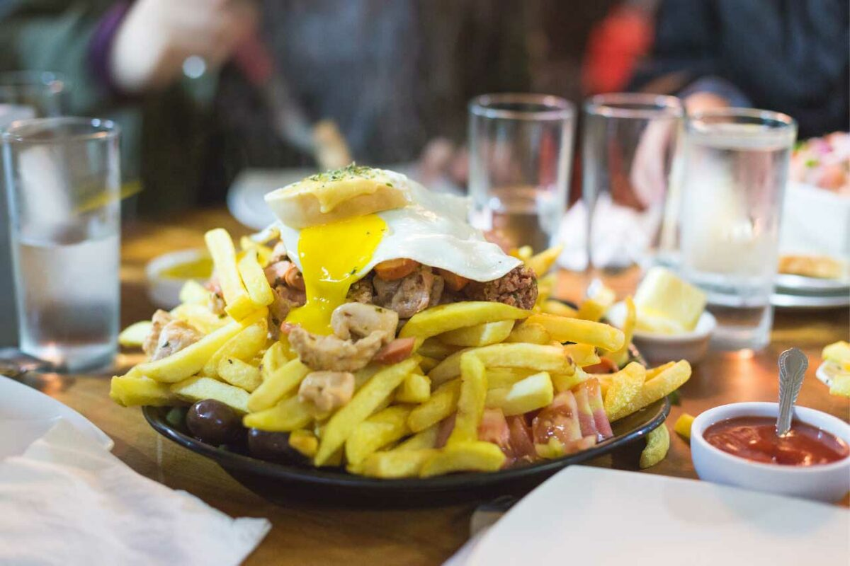 Chorrillana Fries, a Chilean dish of French fries, sausage (or sometimes beef), and a fried egg