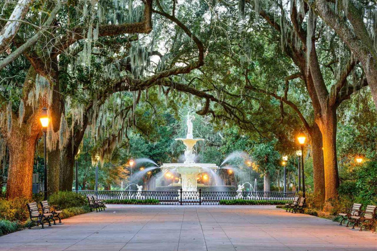 Spanish moss drapes oak trees around the fountain in Forsyth Park, Savannah, Georgia