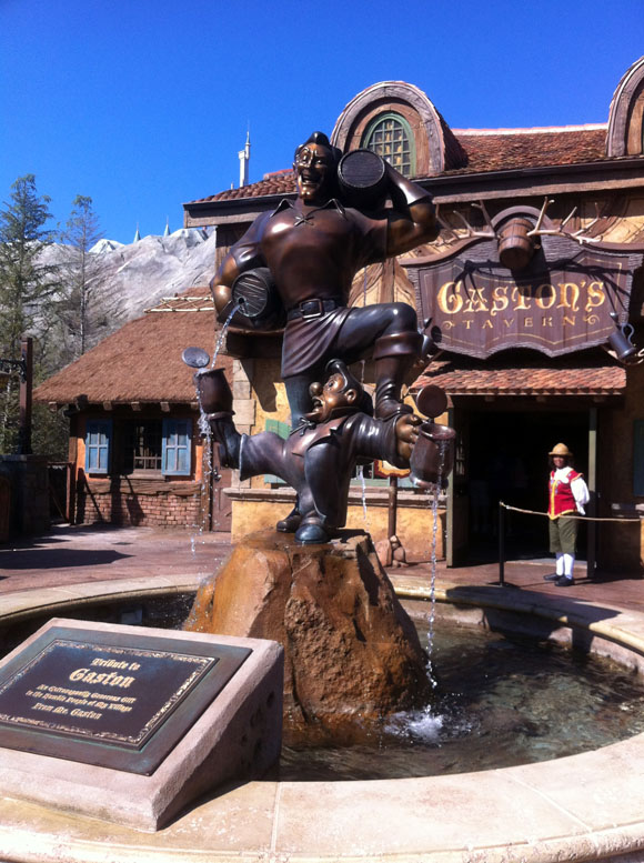 Statue of Gaston and LeFou outside Gaston's Tavern