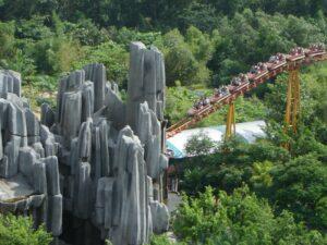 Roller Coaster entering Cave at Suoi Tien Theme Park in Vietnam