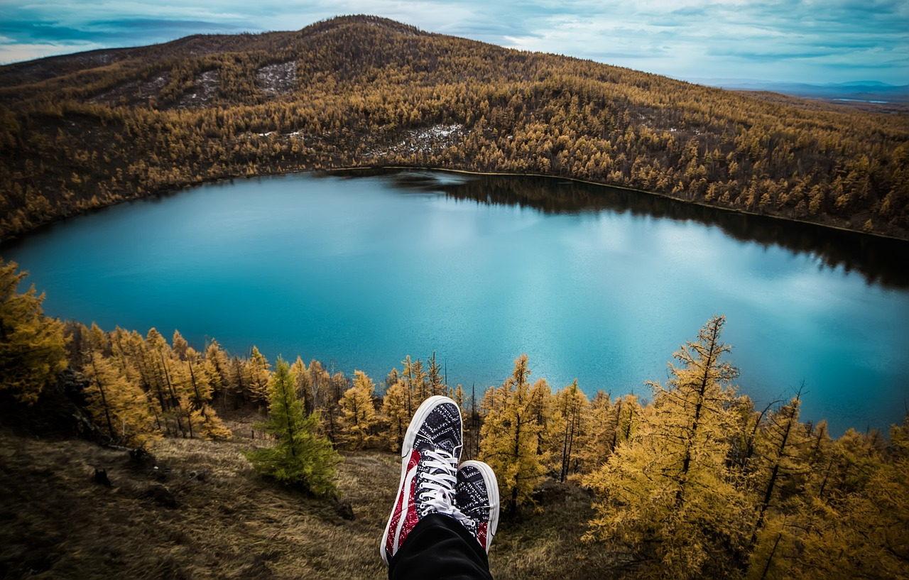 person sitting on mountaintop